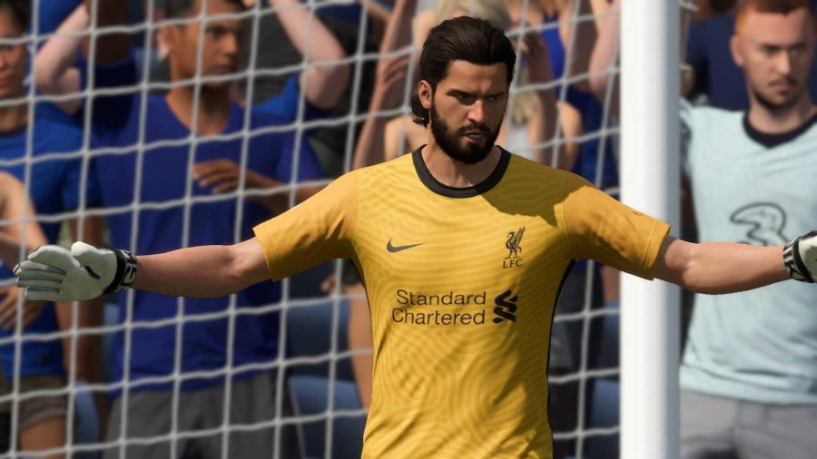 Alisson makes himself look big in the goal, stretching his arms out
