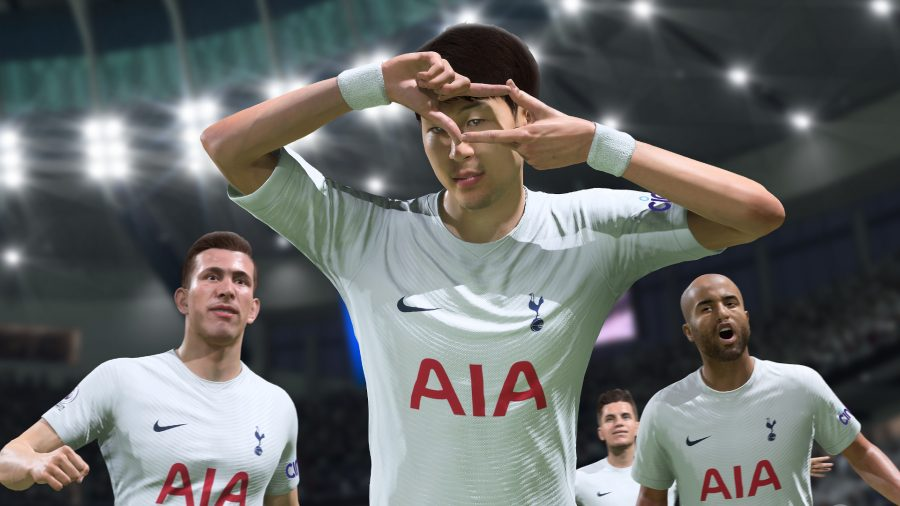 Son makes a photo sign with his hands celebrating a goal in FIFA 22