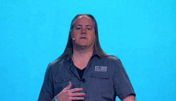 Former Blizzard president J Allen Brack delivering a speech in front of a blue background