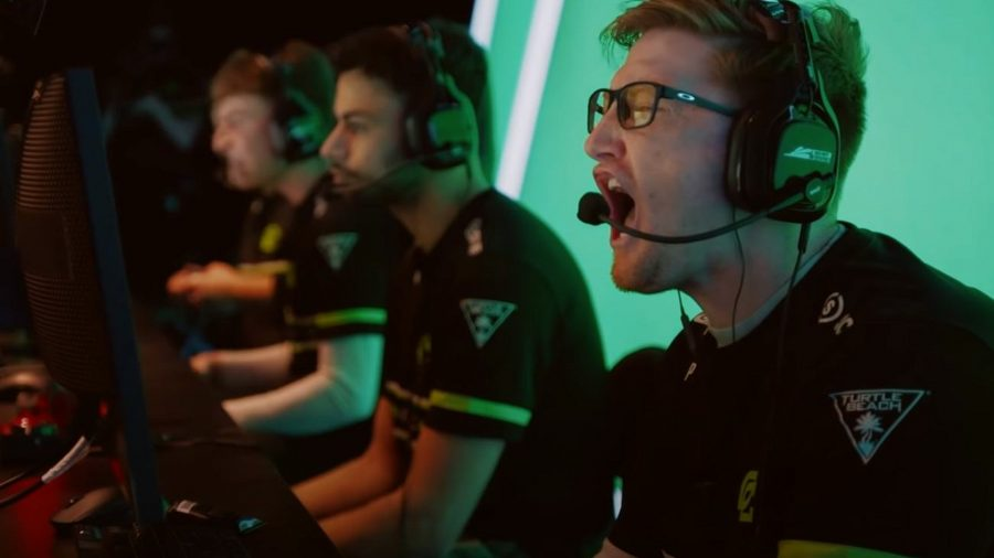 CDL pro Scump roars as OpTic Chicago win a round. He's wearing a black headset, with a black and green jersey