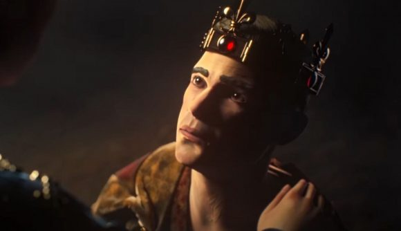 A young man wearing a crown looks up at an out of shot woman who has placed her hand on his shoulder