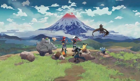 A Pokemon trainer and several Pokemon sit atop a hill gazing out at a snow-capped mountain