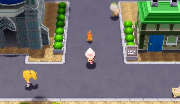 A Pokémon trainer being followed by their Buizel