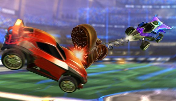 A blue car kicks a red car out the way in Rocket League Rumble