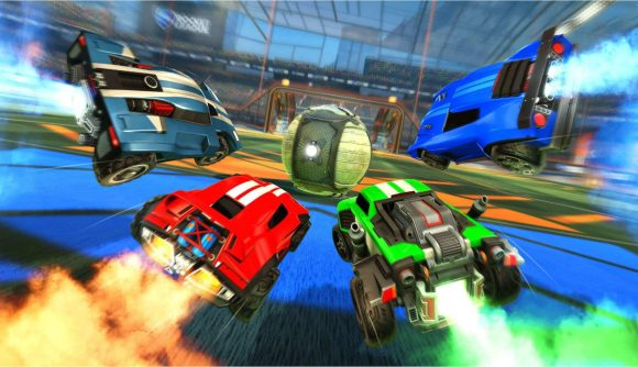 Four cars go for the ball in Rocket League.