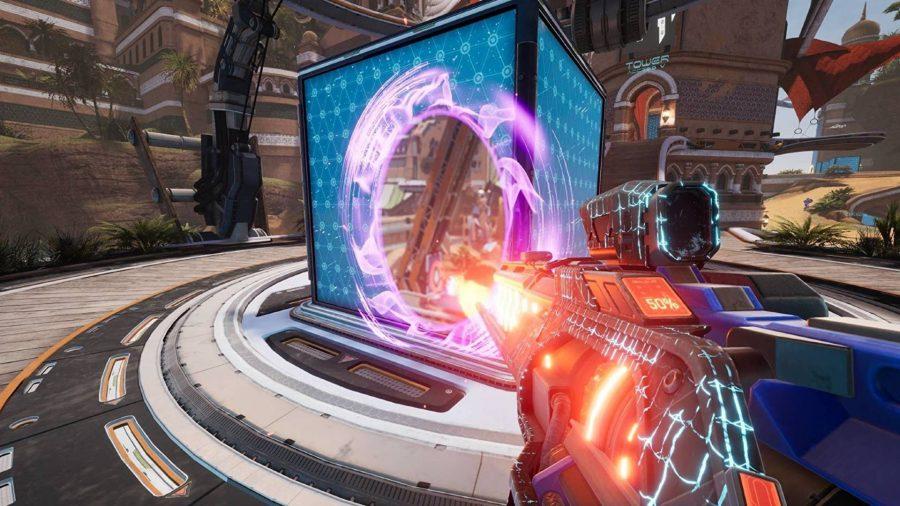 a player can be seen shooting through a portal.