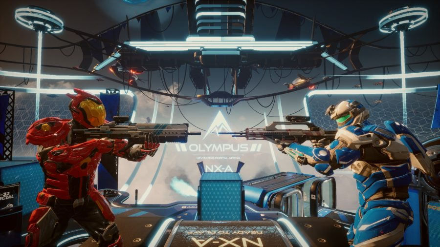 Two Splitgate players with guns drawn stand face to face. One is in red armour, the other in blue