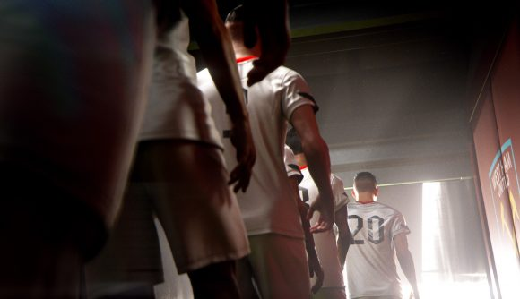 Players walking down a tunnel in white football kits
