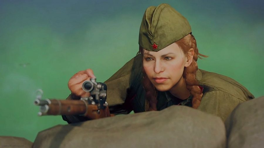 A World War 2 female sniper with ginger hair and a green military cap holds a wooden sniper rifle over a sandbag as part of a Warzone teaser for Call of Duty: Vanguard