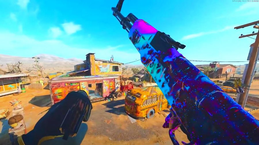 A shot of a weapon in Warzone that has been given a rainbow camo