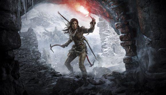 Lara Croft can be seen exploring a cave.