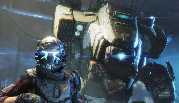 Titanfall 2's protagonist stands alongside his titan BT.