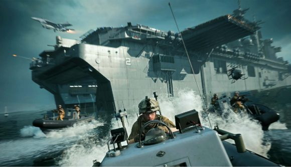 Soldiers can be seen driving away from a large carrier ship on a boat.