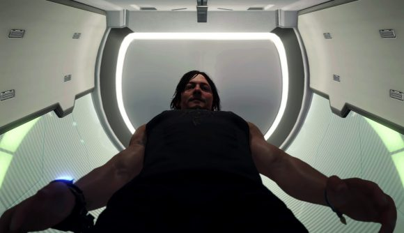 Sam stands above the toilet in his private room, ready to urinate.