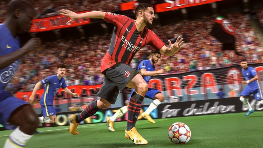 A player runs through the defence with a football at his feet. He's wearing the red and black kit of Milan