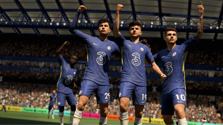 Three Chelsea players in blue kits celebrate a goal in FIFA 22 career mode