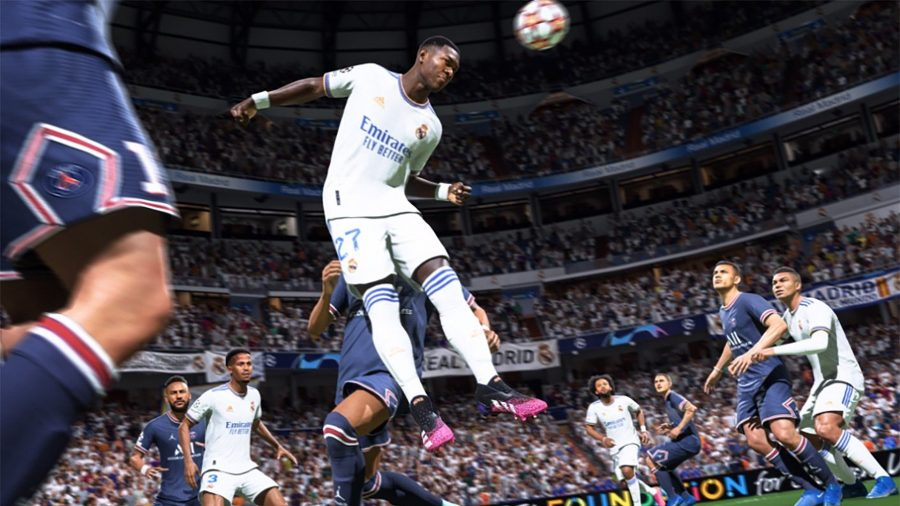 A player in an all-white football kit leaps to head the ball in FIFA 22