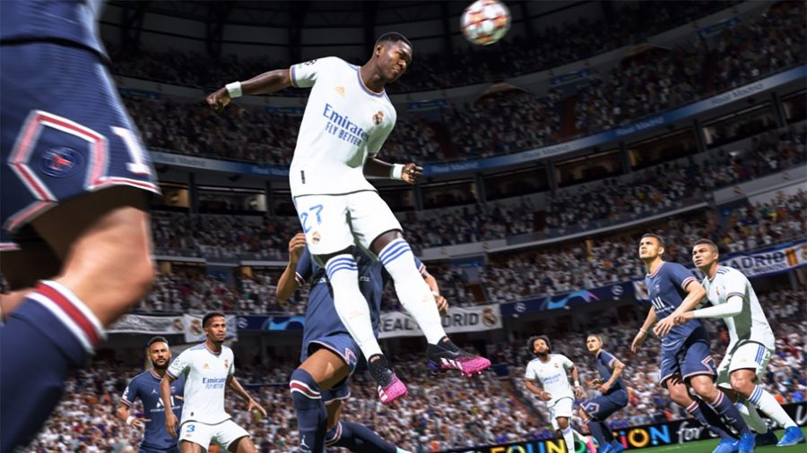 A Real Madrid player leaps to head the ball in FIFA 22