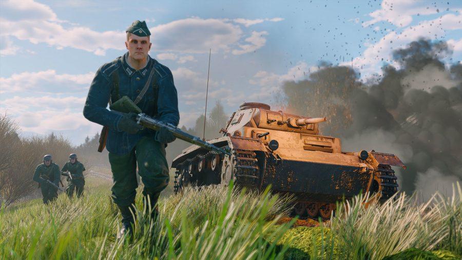 A german footman runs alongside a tank in Enlisted