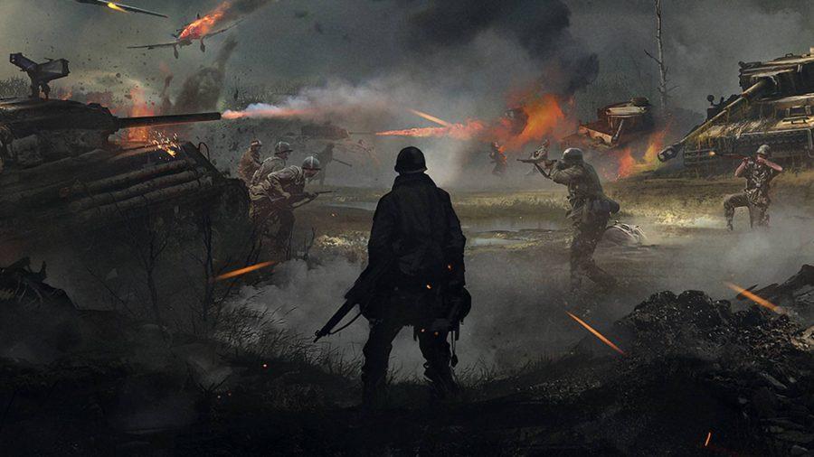A soldier stands overlooking a battlefield.