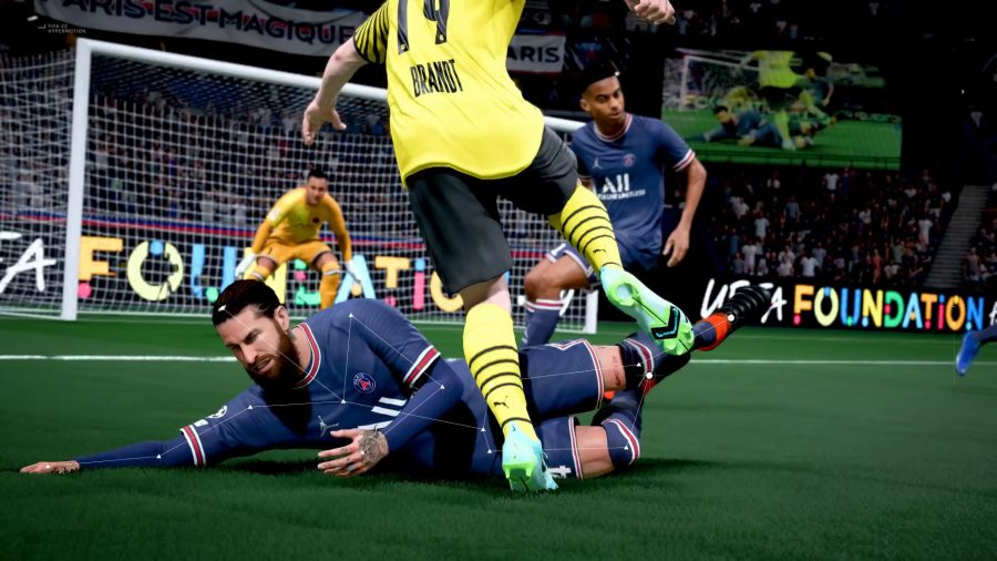 How to defend in FIFA 22: A PSG player goes in for a slide tackle