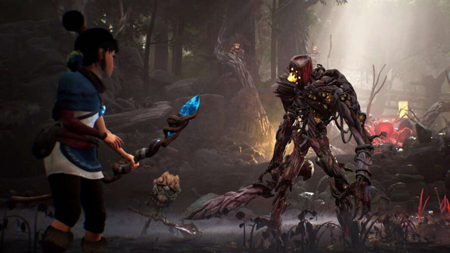 Kena is standing with her staff in her hand, looking at a number of large tree-like creatures, ready to fight.