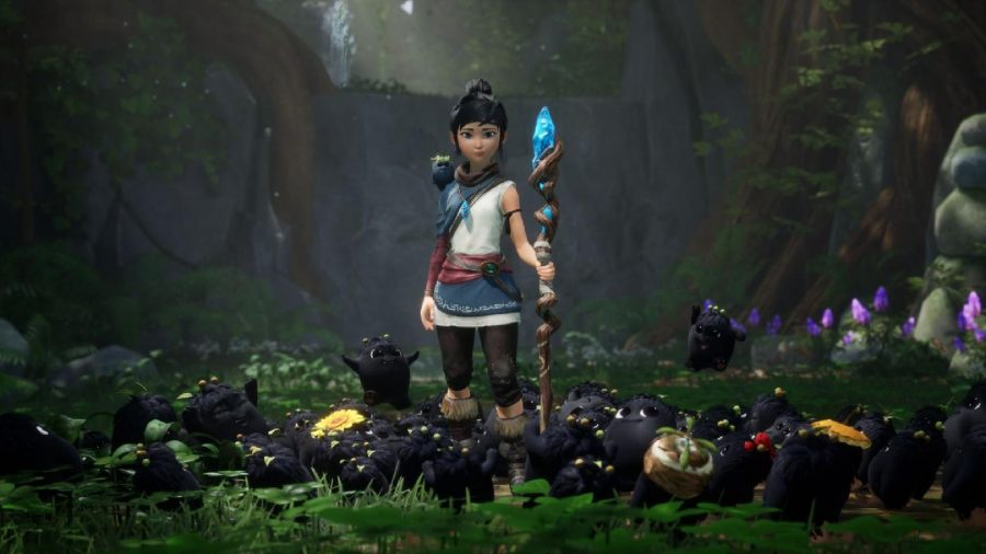 Kena can be seen holding her staff and standing around her Rot.