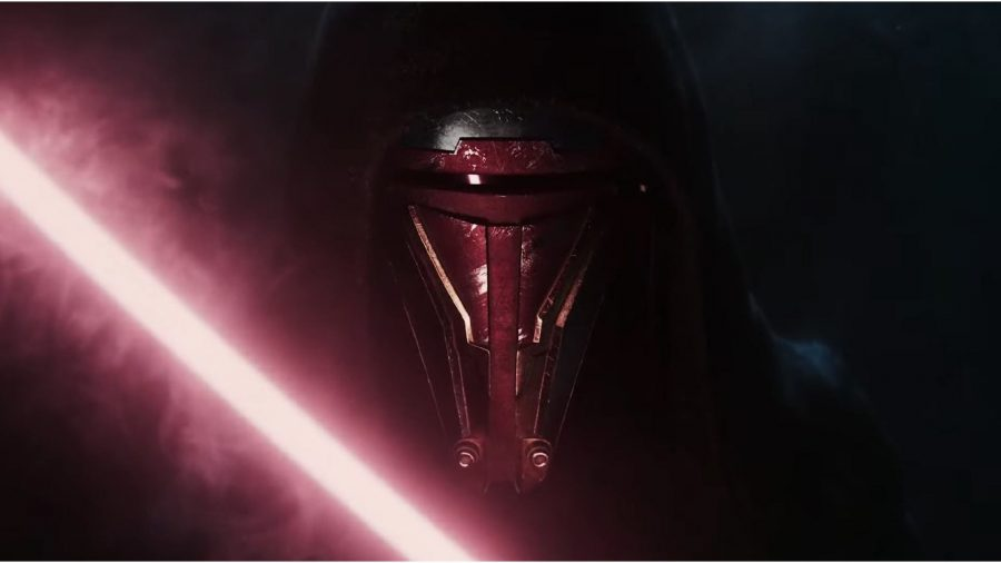 A person can be seen with a lightsaber.
