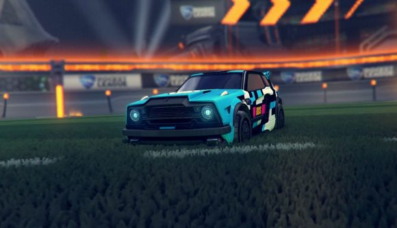 A Rocket League car stationary on the pitch, sporting a light blue esports decal
