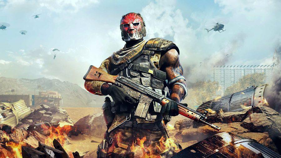 A masked, masculine man holding an assault rifle