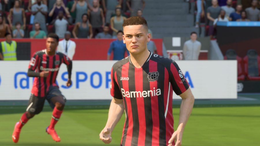 FIFA 22 POTM Wirtz SBC: German player Wirtz in a red and black striped football kit