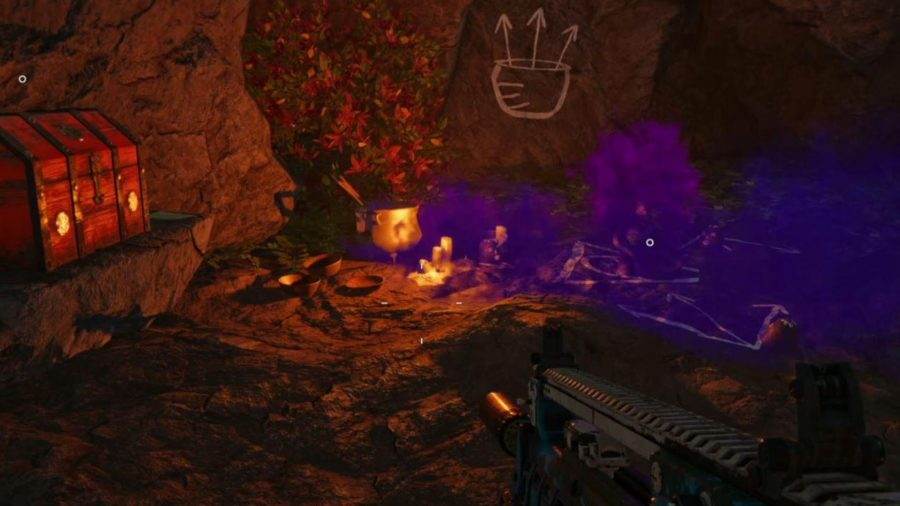 Far Cry 6 Triada Relic Locations: the relic can be seen sitting on the ground with a number of candles around it and a chest on a rock to the left.
