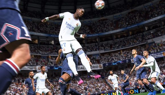 FIFA 22 TOTW 3 predictions: a player in a white football kit leaps to head the ball