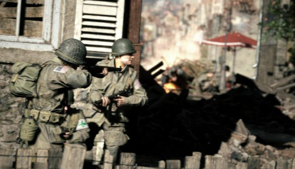 Two soldiers can be seen aiming around a corner in anticipation of an enemy.
