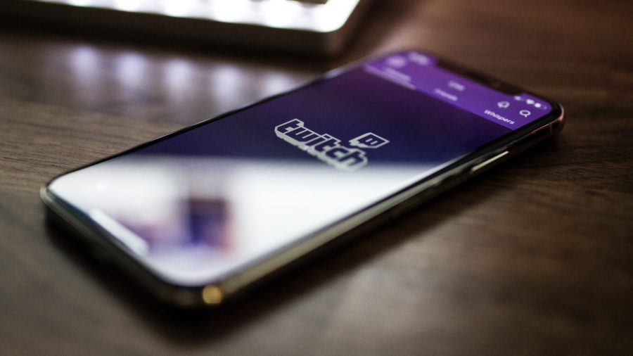 Twitch change password: a mobile phone with the Twitch app on