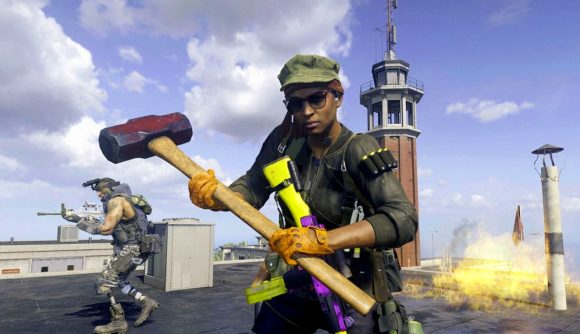 Warzone anti-cheat: A Warzone operator stands on a rooftop holding a large sledgehammer